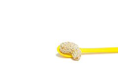 Sweet cashew nut with sesame on yellow spoon Stock Photo