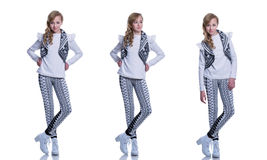Sweet cheerful teenage girl wearing knitted vest, pants and modern boots isolated on white background. Winter clothes. Stock Images