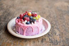 Sweet cheese cake with fresh berries and yoghurt cream. Delicious raspberry cake with fresh strawberries, raspberries. Blueberry, currants and blackberry Royalty Free Stock Photo