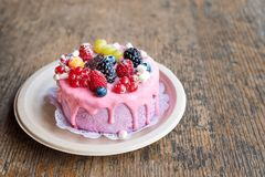 Sweet cheese cake with fresh berries and yoghurt cream. Delicious raspberry cake with fresh strawberries, raspberries. Blueberry, currants and blackberry Royalty Free Stock Images