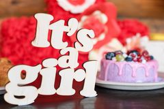 Sweet cheese cake with fresh berries and yoghurt cream and wooden sign Its A Girl. Baby shower party sweets. Royalty Free Stock Photography