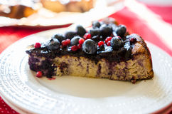 Sweet cheese cake with licorice and fruits Royalty Free Stock Images
