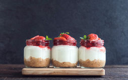 Sweet cheesecake with strawberries Stock Photos