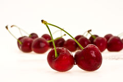 Sweet cherries. Heap to ripe sweet cherries on white background Stock Photography