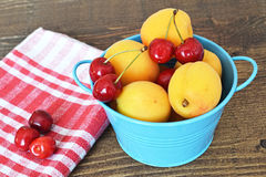 Sweet cherries and apricots Royalty Free Stock Images