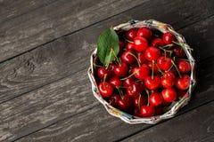 Sweet cherries in basket Stock Images