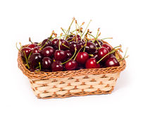 Sweet cherries in basket Stock Photos