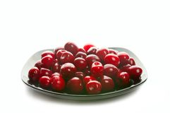 Sweet cherries on black dish Stock Images
