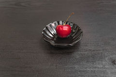Sweet cherries on black table and mint. Sweet Red cherries on black table stock illustration