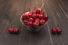 Sweet cherries on black table with star anise and mint. Sweet Red cherries on black table with star anise royalty free illustration