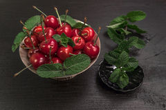 Sweet cherries on black table with star anise and mint. Sweet Red cherries on black table with star anise stock illustration