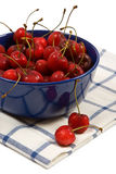 Sweet cherries in the blue cup. S on white background stock photos