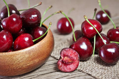Sweet cherries. Bowl of sweet cherries on a wooden background Stock Image