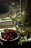 Sweet  cherries, bunch of flowers. Still life sweet  cherries bunch of flowers Stock Photos
