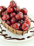 Sweet cherries in chocolate Stock Photos