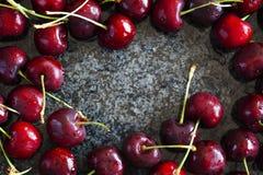 Sweet cherries on dark granite background Stock Photos