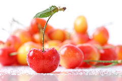 Sweet cherries with droplets isloated on white Royalty Free Stock Images