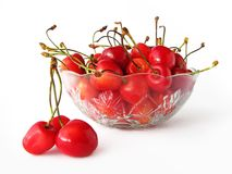Sweet cherries in glass bowl. Isolated on white background Royalty Free Stock Image