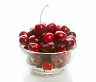 Sweet cherries in glass ware. Heap of sweet cherries in glass ware, isolated on white Royalty Free Stock Photography