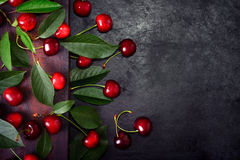 Sweet cherries with green leaves Stock Images