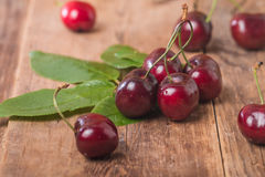 Sweet cherries with green leaves Royalty Free Stock Photo