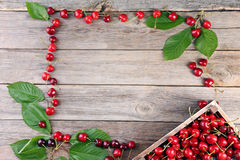 Sweet cherries. On grey wooden table Royalty Free Stock Image