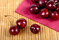 Sweet cherries on a mat. Heap of sweet cherries on a mat Stock Photos