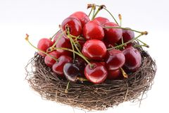 Sweet cherries in a nest Stock Photos