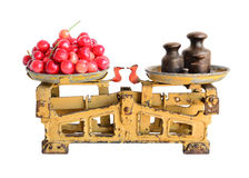 Sweet cherries on old scales Stock Photos