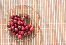 Sweet cherries. Red fresh juisy sweet cherries served with glass plate Stock Photography