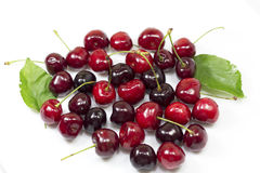 Sweet cherries and sheet Stock Photography