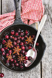 Sweet cherries simmered with anise stars and cinnamon Stock Image