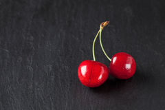 Sweet cherries on slate Royalty Free Stock Images