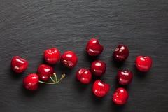 Sweet cherries on slate Stock Photos