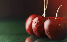 Sweet cherries on table with water drops macro background Stock Photo