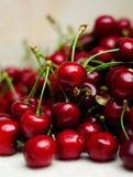 Sweet cherries with water drops in the kitchen Stock Image