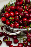 Sweet cherries with water drops in the kitchen Stock Photo