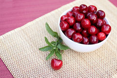 Sweet cherries in a white cup Royalty Free Stock Photos