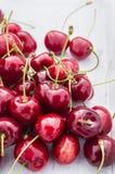 Sweet cherries on white wooden table Stock Photo
