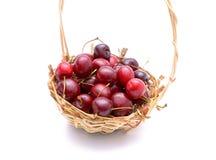 Sweet cherries in wicker basket Stock Images