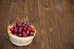 Sweet cherries on wooden background Royalty Free Stock Images