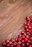 Sweet cherries on wooden background Royalty Free Stock Photos