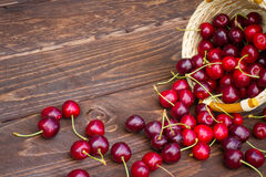 Sweet cherries on wooden background Stock Photos