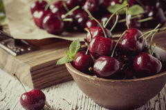 Sweet cherries  on wooden background,  retro style, grained Stock Photo