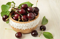 Sweet cherries in a wooden bowl Royalty Free Stock Images