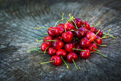 Sweet cherries on a wooden surface Stock Image