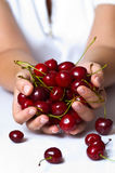 Sweet cherry. In woman hand royalty free stock photos