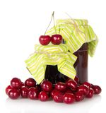 Sweet cherry berries on a jar of jam Royalty Free Stock Image