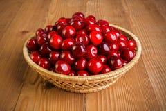 Sweet cherry berries (Prunus avium) in wicker plate Stock Photo