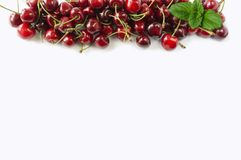 Sweet cherry berries on white background cutout. Cherry fruit at border of image with copy space for text. Background berries. Various fresh summer berries royalty free stock photography